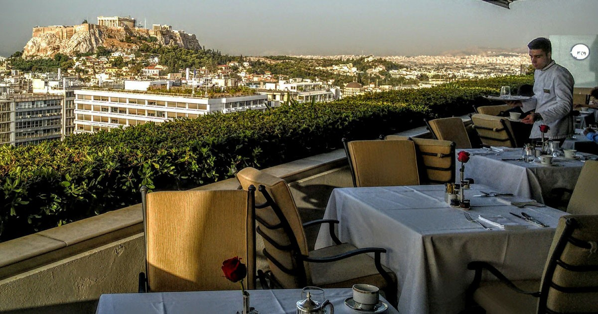 Dinner atop the Grande Bretangne Hotel with a view of the Parthanon, Athens, Greece