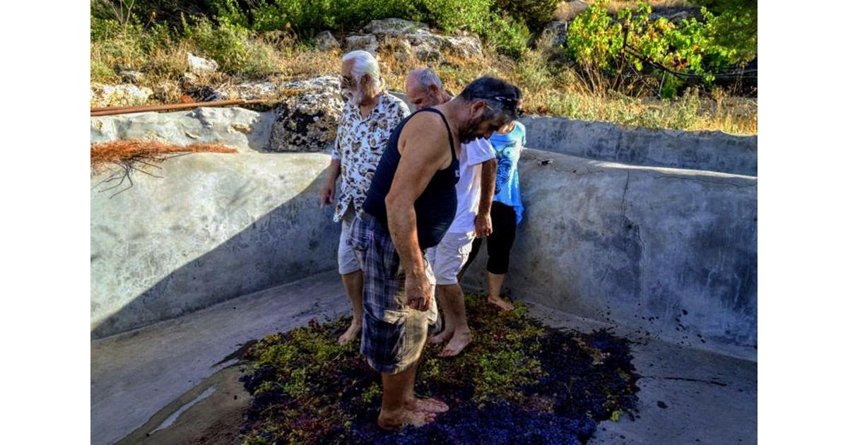 Stomping grapes, Paros Island, Greece - photo by Kurt Winner
