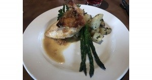 Baked chicken with lemon, fried potatoes and asparagus