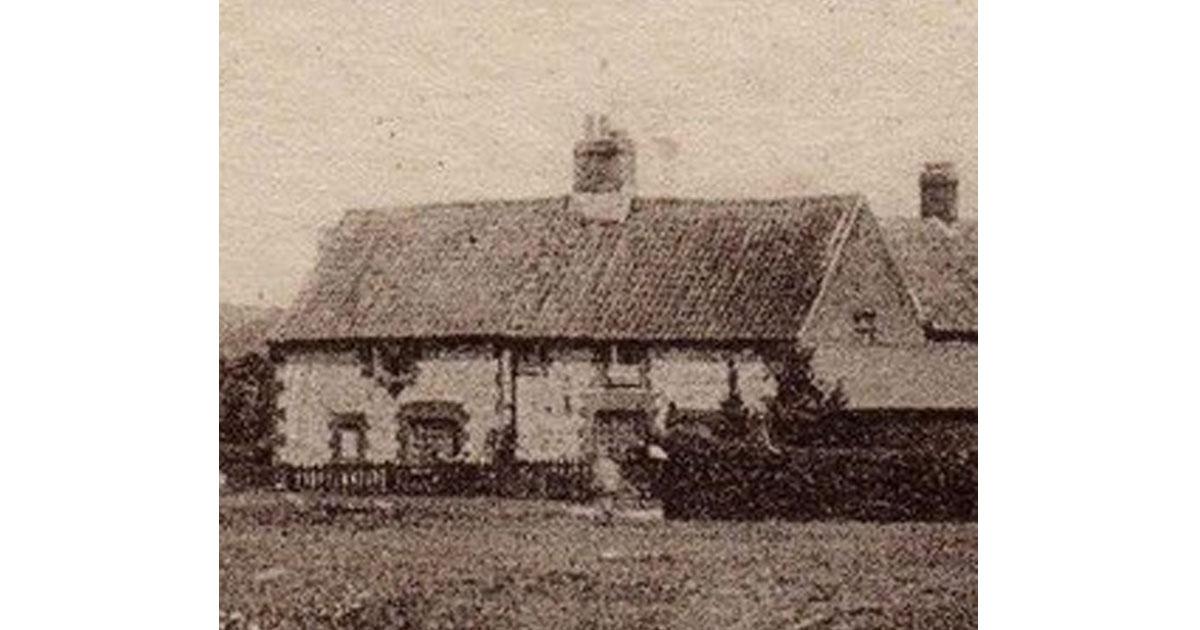 Flint cottage showing brick corners etc. c1920