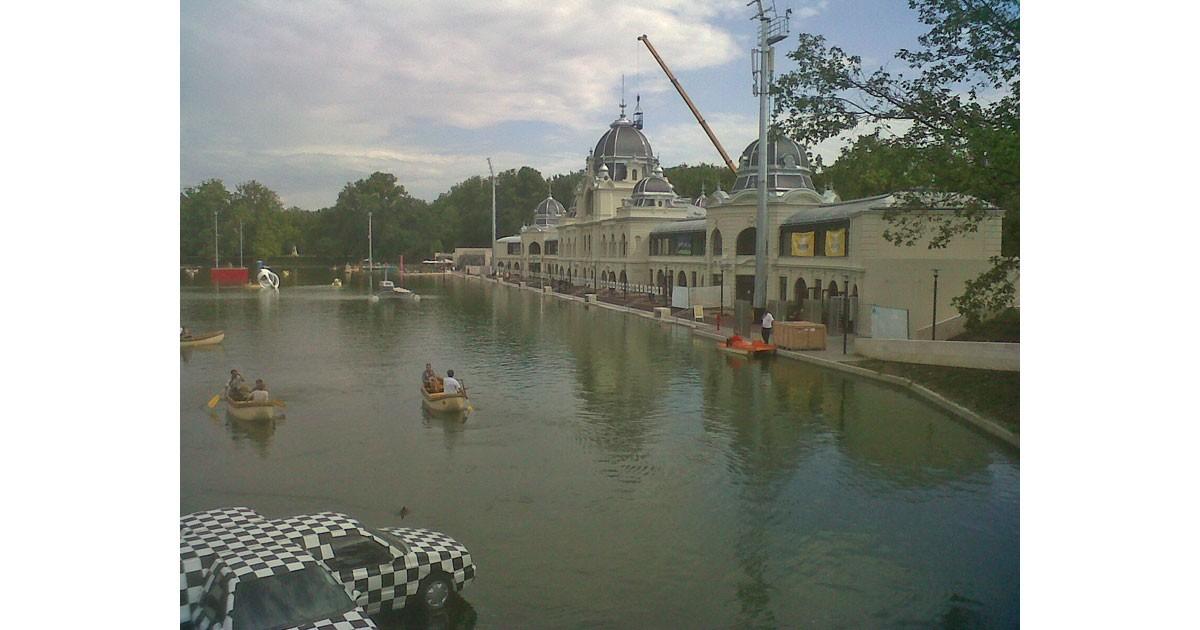 City Park in Budapest which has a man-made lake. In summer there are boats and in winter there is skating.  The white building on the right is the skating palace built in the 1800s.