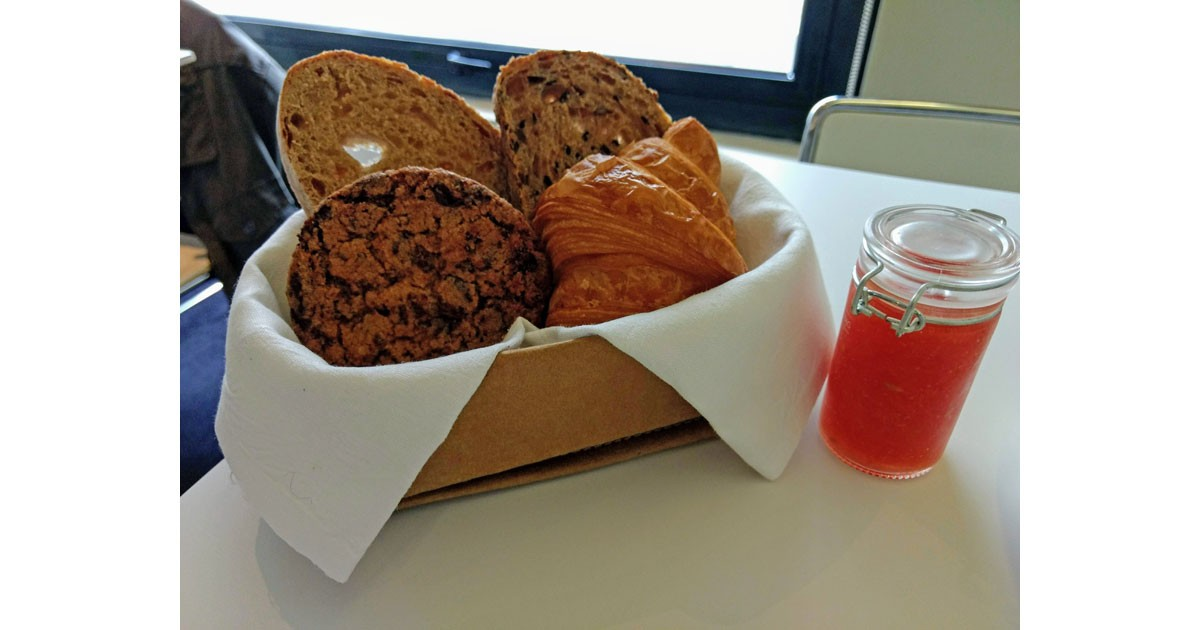 Organic, home baked breads with grated tomoato with flaky salt_ and cookies for breakfast_ Of course!